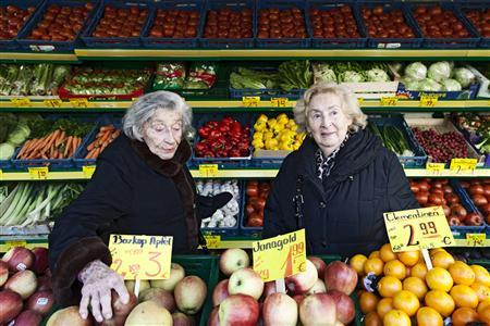 This undated promotional handout picture shows holocaust survivors Bella Katz (L) and Regina Karolinski (Oma) shopping for ingredients in Berlin, where they share an apartment that is the setting for ''Oma & Bella'', a documentary about their cooking and its connection to their past. Scenes from the new documentary ''Oma & Bella'' about two octogenarian friends living together in Berlin are warm, but the hunger to learn more about their past as Holocaust survivors creates a suspenseful undercurrent throughout the film, which is being released on iTunes and Amazon in the United States on Tuesday. The sometimes jarring shifts from cozy kitchen scenes of chopping and sauteing to starkly lit interviews in which they reluctantly reveal some of the horrors they survived as Jewish girls in World War Two are purposeful, filmmaker Alexa Karolinski said. To match Story FILM-OMA&BELLA/ REUTERS/Bella Lieberberg/Handout