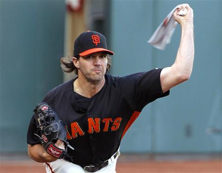 San Francisco Giants starting pitcher Barry Zito warms-up his arm with a towel during practice for the MLB World Series in San Francisco, October 23, 2012. REUTERS/Danny Moloshok