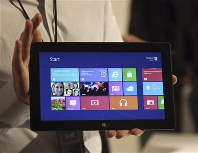 A Microsoft representative holds a new Surface tablet computer as it is unveiled by Microsoft in Los Angeles, California, in this June 18, 2012 file photo. In 20 years in China, Microsoft Corp hasn't had much luck. It is the world's largest market for PCs and yet with piracy rates as high as 77 percent, the software company is seeing only a fraction of the revenue it could collect. That might change with the launch of its Surface tablet, which goes on sale online in China at the same time as a handful of other countries. The Surface is a rare piece of Microsoft hardware, and will run the company's new Windows 8 operating system. REUTERS/David McNew/Files