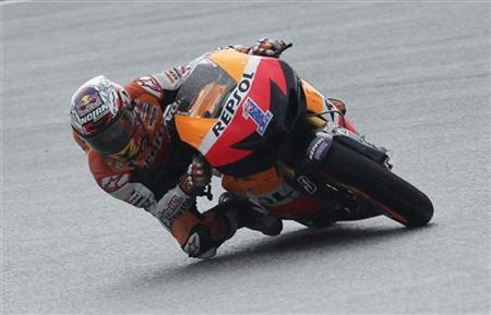 Honda MotoGP rider Casey Stoner of Australia takes a corner during the second lap of the Malaysian Grand Prix in Sepang October 21, 2012. REUTERS/Stringer
