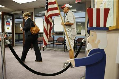 Voters arrive to complete in-person absentee voting at the Fairfax County Governmental Center in Fairfax, Virginia, October 3, 2012. REUTERS/Jonathan Ernst