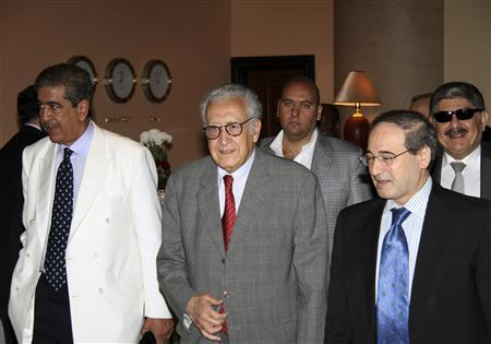 U.N.-Arab League peace envoy for Syria Lakhdar Brahimi (C) walks with Syrian Deputy Foreign Minister Faisal Mekdad (front R) and Mokhtar Lamani, Brahimi's representative in Syria (L), before his departure in Damascus October 23, 2012. Brahimi, who ended a four-day visit to Damascus on Tuesday, has pushed for a ceasefire to mark the Islamic holiday of Eid al-Adha, which starts on Friday, hoping for a respite from daily death tolls of around 150. REUTERS/stringer