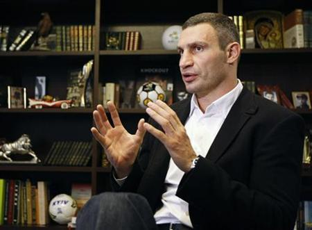 Heavyweight boxing champion and UDAR (Punch) party leader Vitaly Klitschko speaks during an interview at his office in Kiev October 8, 2012. REUTERS/Anatolii Stepanov