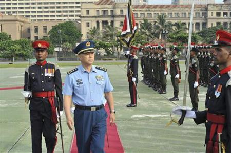 File picture of General Ma Xiaotian of the Chinese People's Liberation Army, inspecting the army parade at the army headquarters in Colombo December 13, 2011. REUTERS/Army Media/Handout