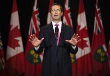 Ontario Premier Dalton McGuinty speaks to the media after making an announcement to resign from the leadership of the Ontario provincial Liberal party at Queen's Park in Toronto, October 15, 2012. REUTERS/Mark Blinch