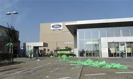 Trash lies outside the empty Ford assembly plant in Genk after an emergency meeting between workers and management October 24, 2012. REUTERS/Laurent Dubrule (BELGIUM - Tags: BUSINESS EMPLOYMENT TRANSPORT)