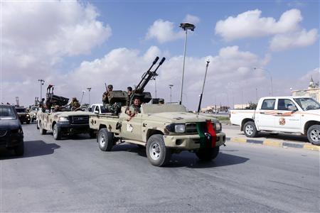 Libyan militias aligned with the defence ministry drive around a roundabout in the centre of the former Gaddafi stronghold of Bani Walid October 24, 2012. REUTERS/Ismail Zitouny