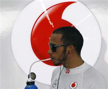 McLaren Formula One driver Lewis Hamilton of Britain takes a drink inside his team garage during the first practice session of the South Korean F1 Grand Prix at the Korea International Circuit in Yeongam October 12, 2012. REUTERS/Lee Jae-Won