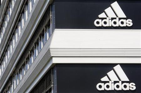 Adidias logos are seen on the company's building in Landersheim near Strasbourg March 31, 2009. REUTERS/Christian Hartmann