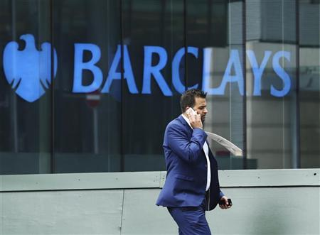 A city worker passes a Barclays bank branch in Canary Wharf, east London August 30, 2012. REUTERS/Olivia Harris
