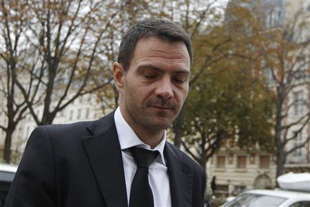 Former Societe Generale trader Jerome Kerviel arrives at the Paris court for the verdict in his appeal trial October 24, 2012. REUTERS/Gonzalo Fuentes