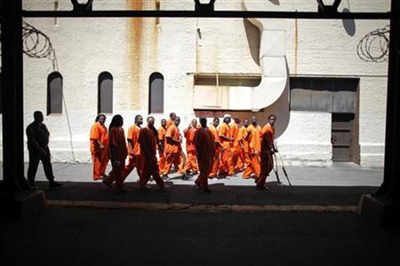 Inmates walk through San Quentin state prison in San Quentin, California, June 8, 2012. REUTERS/Lucy Nicholson
