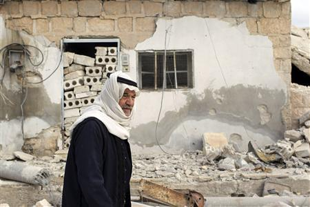 A man walks past a recently shelled area in Atareb, in the Idlib governorate October 24, 2012. REUTERS/Asmaa Waguih