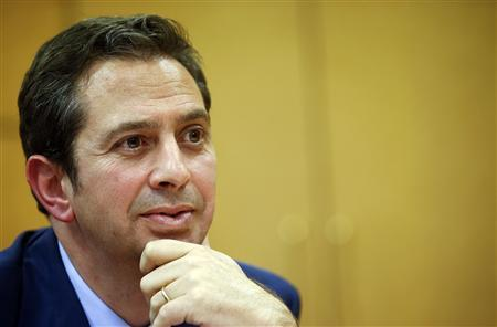 Spain's head of Treasury Inigo Fernandez de Mesa smiles as he listens to a question during an interview with Reuters at his office in Madrid October 24, 2012. REUTERS/Juan Medina