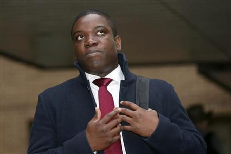 Former UBS trader Kweku Adoboli arrives at Southwark Crown Court in central London October 22, 2012. Adoboli is on trial accused of fraud and false accounting that cost the Swiss bank $2.3 billion. He has pleaded not guilty. REUTERS/Suzanne Plunkett