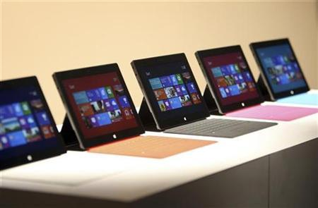 New Surface tablet computers by Microsoft are displayed at its unveiling in Los Angeles, California, June 18, 2012. REUTERS/David McNew