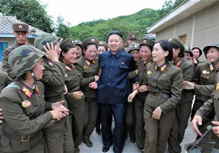 North Korean leader Kim Jong-un (C) visits the Thrice Three-Revolution Red Flag Kamnamu (persimmon tree) Company under the Korean People's Army Unit 4302 in this undated picture released by the North's official KCNA news agency in Pyongyang on August 24, 2012. KCNA did not state precisely when the picture was taken. REUTERS/KCNA