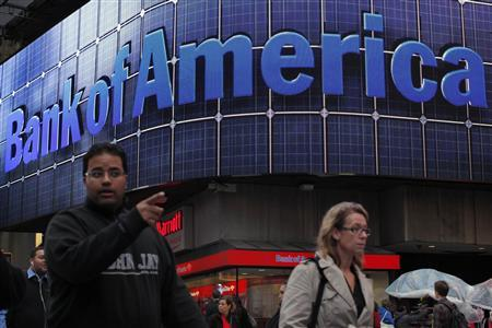 People walk next to a Bank of America's branch in New York October 24, 2012. The United States filed a fraud lawsuit against Bank of America Corp, accusing it of causing taxpayers more than $1 billion of losses by selling thousands of toxic mortgage loans to Fannie Mae and Freddie Mac. REUTERS/Eduardo Munoz