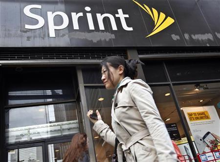 A woman walks past a Sprint store in New York's financial district, October 15, 2012. REUTERS/Brendan McDermid