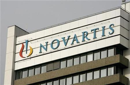 The logo of Swiss drugmaker Novartis is seen on the top of an office building at the company's plant in Basel January 28, 2009. REUTERS/Arnd Wiegmann