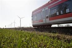File handout photo made available August 22, 2011, shows a train of German railway company Deutsche Bahn at the Maerkisch Linden windpark near Neureupin April 2011. It won't be easy to run a national railway on renewable energy like wind, hydro and solar power but that is what Germany's Deutsche Bahn aims to do for one simple reason: it's what consumers want. The railway's new push for a larger share of renewable energy to operate trains that transport 1.9 billion passengers and 415 million tonnes of freight each year has won applause from environmental groups. They have cheered Deutsche Bahn's partnerships with wind and hydroelectric power suppliers and its exploratory moves into harvesting solar power from the roofs of its 5,700 stations. Picture taken April 2011. TO GO WITH STORY GERMANY-RENEWABLES/RAILWAYS REUTERS/Michael Neuhaus/Deutsche Bahn/Handout (GERMANY - Tags: ENERGY ENVIRONMENT TRANSPORT) FOR EDITORIAL USE ONLY. NOT FOR SALE FOR MARKETING OR ADVERTISING CAMPAIGNS. THIS IMAGE HAS BEEN SUPPLIED BY A THIRD PARTY. IT IS DISTRIBUTED, EXACTLY AS RECEIVED BY REUTERS, AS A SERVICE TO CLIENTS