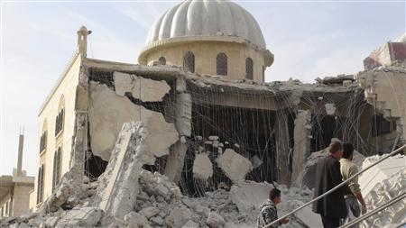 Residents inspect Bilal mosque, which activists said was damaged after it was fired by a Syrian Air Force fighter jet loyal to Syria's President Bashar al-Assad, at Marat al-Numan near the northern province of Idlib October 24, 2012. REUTERS/Zakwan Hadeed/Shaam News Network/Handout
