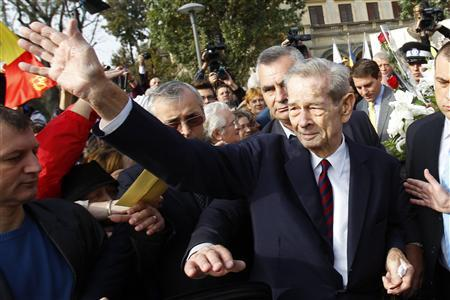Romania's former king Michael waves to his supporters after a ceremony in downtown Bucharest October 25, 2012. REUTERS/Bogdan Cristel
