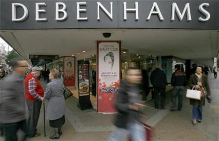 Pedestrians walk past the Debenhams store on Oxford Street, in central London October 19, 2008. REUTERS/Andrew Winning