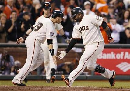San Francisco Giants' Pablo Sandoval (R) celebrates with teammate Marco Scutaro after hitting a two RBI home run against the Detroit Tigers in the third inning during Game 1 of the MLB World Series baseball championship in San Francisco, October 24, 2012. REUTERS/Lucy Nicholson