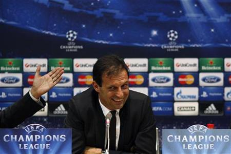AC Milan's coach Massimiliano Allegri smiles during a news conference on the eve of their Champions League soccer match against Malaga at La Rosaleda stadium in Malaga, southern Spain October 23, 2012. REUTERS/Jon Nazca