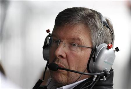 Mercedes Formula One team principal Ross Brawn follows the race from the pit wall during the Chinese F1 Grand Prix at Shanghai International circuit April 15, 2012. REUTERS/Aly Song
