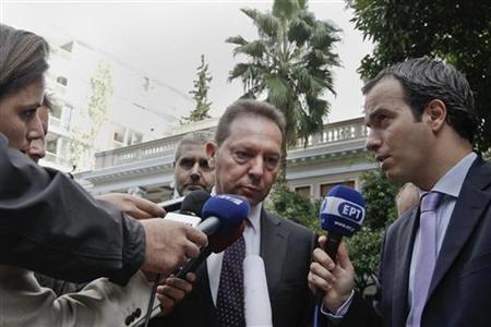 Greece's Finance Minister Yannis Stournaras (C) listens to reporters' questions as he leaves the Prime Minister's office in Athens October 25, 2012. REUTERS/Yorgos Karahalis