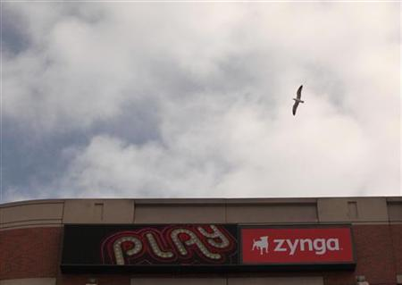 A bird flies above the corporate headquarters of Zynga Inc, the social network game development company, in San Francisco, California April 26, 2012. REUTERS/Robert Galbraith