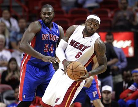 Detroit Pistons' Jason Maxiell (L) clashes with Miami Heat's LeBron James in a preseason NBA basketball game at the Miami Heat's home arena in Miami, Florida October 18, 2012. REUTERS/Andrew Innerarity