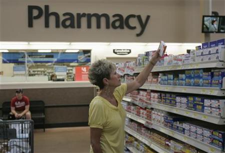 A customer shops for over-the-counter medicine at a Wal-Mart Supercenter in Rogers, Arkansas June 5, 2008. REUTERS/Jessica Rinaldi