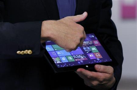 Microsoft CEO Steve Ballmer shows a tablet before the launch of Windows 8 operating system in New York, October 25, 2012. REUTERS/Lucas Jackson