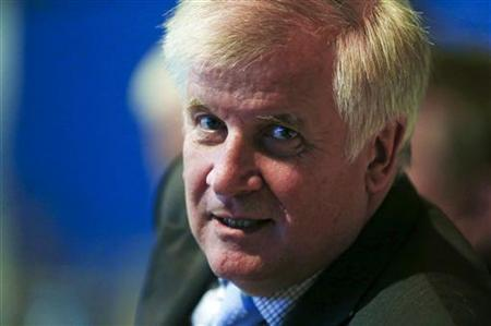 Bavarian Prime Minister Horst Seehofer waits for the arrival of German Chancellor Angela Merkel during a Christian Social Union (CSU) party meeting in Munich October 19, 2012. REUTERS/Michael Dalder