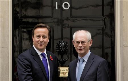 The President of the European Council, Herman Van Rompuy, is greeted by Britain's Primer Minister David Cameron (L) in Downing Street in London October 25, 2012. REUTERS/Neil Hall