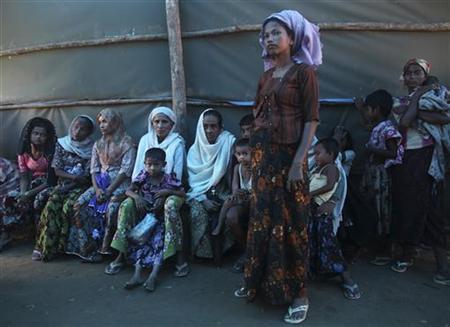 Shofica Belcom, 25, waits with other mothers at a Myanmar Red Cross health clinic near Sittwe, capital of Myanmar's Rakhine state October 14, 2012. REUTERS/Joe Cropp/International Federation of Red Cross/Handout
