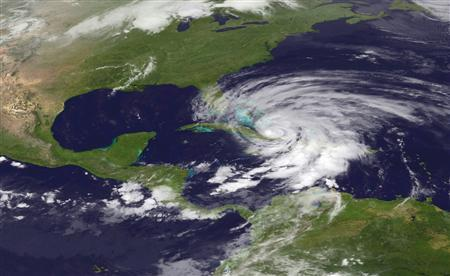 Hurricane Sandy is seen churning northwards in this NOAA handout satellite image taken on October 25, 2012. The hurricane, strengthening rapidly after crossing the warm Caribbean Sea, slammed into southeastern Cuba early on Thursday with 105 mph winds that cut power and blew over trees across the city of Santiago de Cuba. REUTERS/NOAA National Hurricane Center/Handout