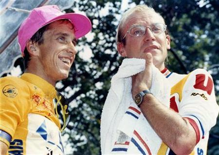 Greg LeMond of the U.S. (L) and Tour de France leader Laurent Fignon of France stand on the podium at the end of the Tour de France cycling race in Paris in this July 23, 1989 file picture. REUTERS/Charles Platiau/Files