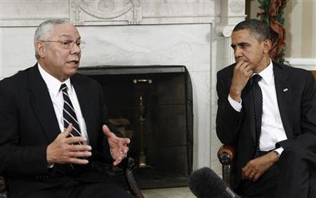 U.S. President Barack Obama listens to former Secretary of State Colin Powell (L) during their meeting in the Oval Office at the White House in Washington, December 1, 2010. REUTERS/Jim Young