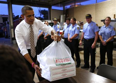 U.S. President Barack Obama delivers doughnuts to fire fighters at a fire house in Tampa, Florida October 25, 2012. REUTERS/Kevin Lamarque