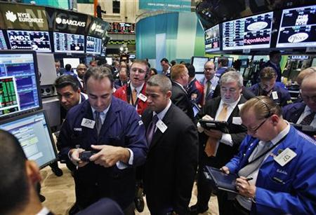 Wall Street manages slim gain, Apple falls after results