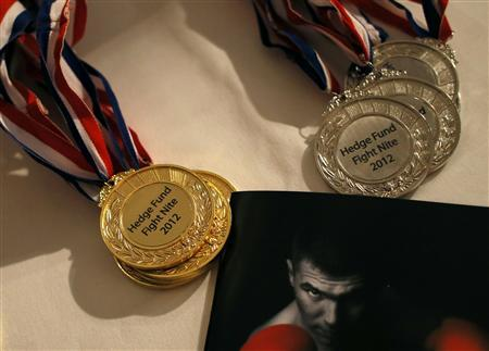 Medals are displayed during the Hedge Fund Fight Nite white collar charity boxing event in Hong Kong October 25, 2012. REUTERS/Bobby Yip
