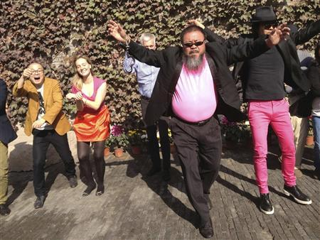 Dissident Chinese artist Ai Weiwei (front) dances with his friends as they make a cover version of music video of ''Gangnam Style'' by South Korean singer Psy at the courtyard of Ai's studio in Beijing, October 24, 2012. Picture taken October 24, 2012. REUTERS/Courtesy of Ai Weiwei/Handout