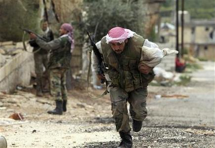 A member of the Free Syrian Army runs along a street to avoid sniper fire during fighting against pro-government forces in Harem town, Idlib Governorate, October 25, 2012. REUTERS/Asmaa Waguih