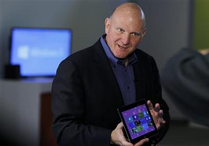 Microsoft CEO Steve Ballmer holds a tablet before the launch of Windows 8 operating system in New York, October 25, 2012. REUTERS/Lucas Jackson