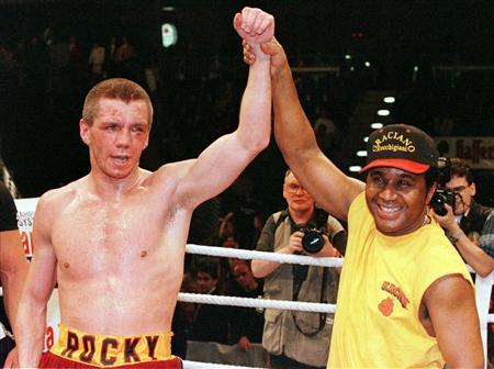 German super middleweight boxer Graciano ''Rocky'' Rocchigiani (L) celebrates with his trainer Emanuel Steward (R) of the U.S. after winning his fight against U.S. boxer John Scully in Berlin, in this file picture taken March 22, 2007. REUTERS/Fabrizio Bensch/Files