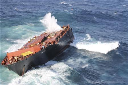 The bow section of the stricken container ship Rena remains above water about 14 nautical miles (22 km) from Tauranga on the east coast of New Zealand's North Island in this April 4, 2012 handout picture. REUTERS/Maritime New Zealand/Handout